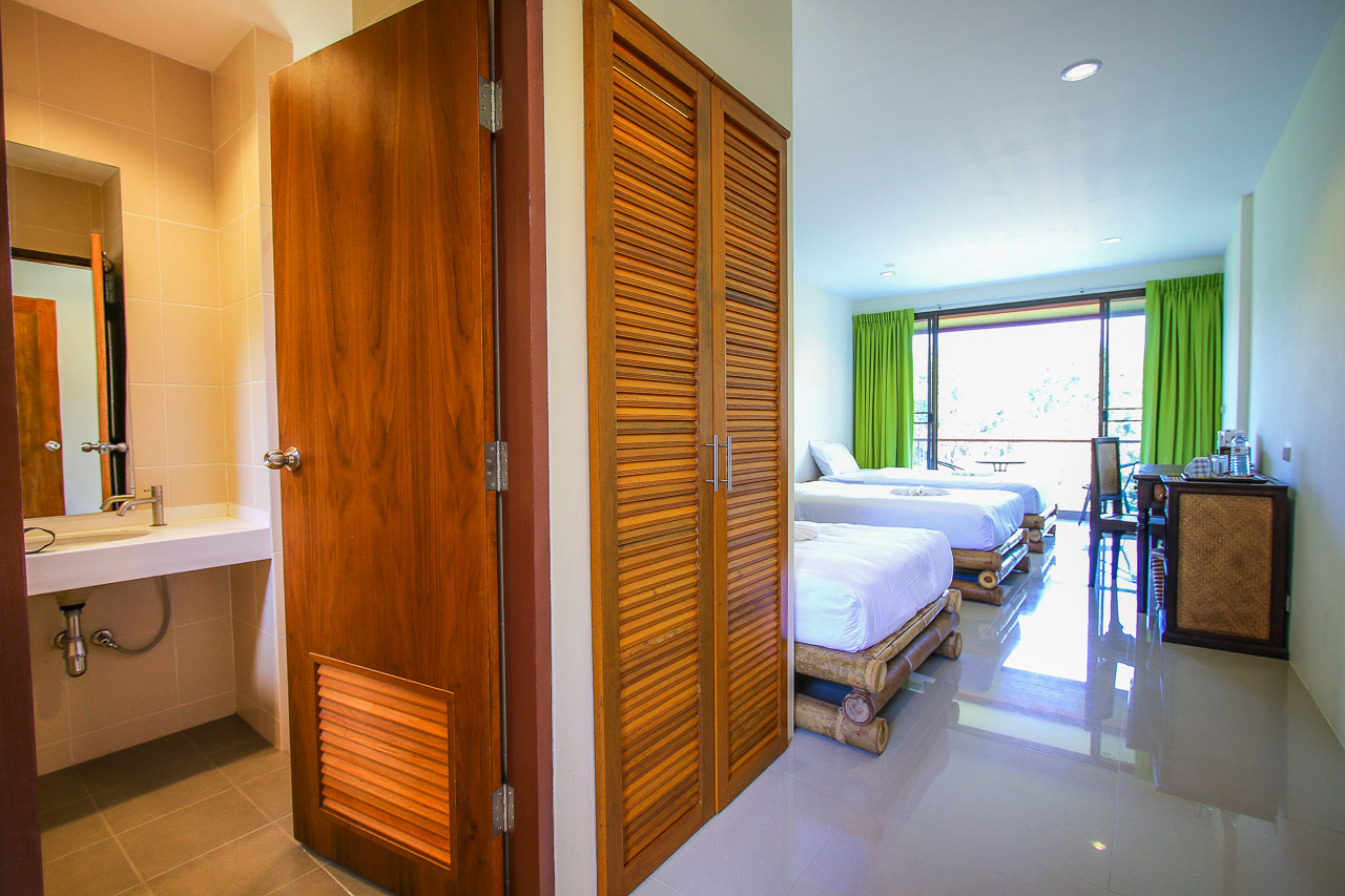 Standard rooms each have three single beds and balconies in new hotels.
