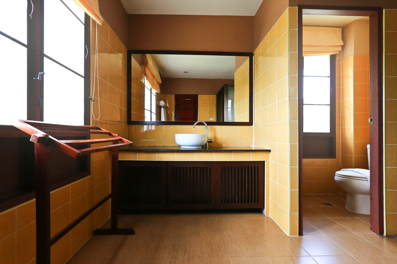 Beside the toilet room, the restroom area also has a basin-and-mirror area for washing or shaving.